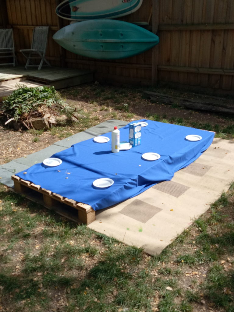 We used pallets to make a table low to the ground.